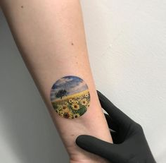 30 The field of sunflowers in a tattoo on the wrist