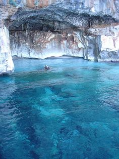 Golfo di Orosei, Sardinia, Italy. The Gulf of Orosei is located along the central eastern coast of Sardinia. The gulf consists of sandy beaches and is surrounded by vertical limestone cliffs, cut by deep gorges carved by ancient rivers now disappeared or swallowed up from the plateau karst above.