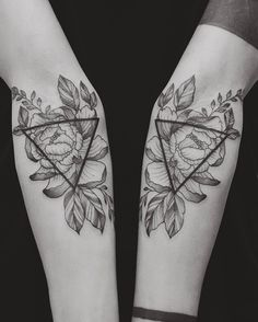 Floral and geometric tattoo by Tritoan Ly
