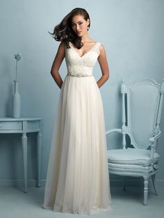 Allure 9205 This gown sweetly pairs lace and fluid tulle for an effortlessly…