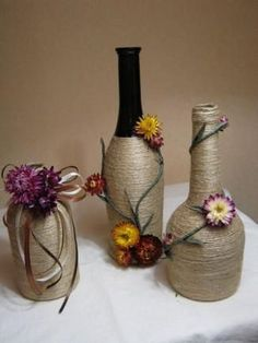 Rustic decorated wine bottle, twine wrapped wine bottle, b Glass Bottle Crafts, Wine Bottle Art, Diy Bottle, Wrapped Wine Bottles, Liquor Bottles, Bottles And Jars, Glass Bottles, Bottle Centerpieces, Vases