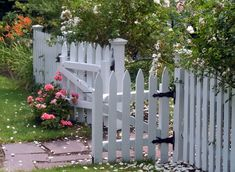 White picket garden fence with double gate