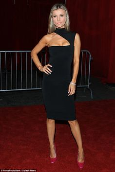 Joanna Krupa flaunted her toned figure in a curve hugging black dress at the Maxim Hot 100 event in Hollywood
