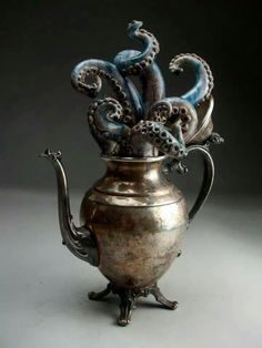 Octopus in a silver teapot by Grafton Pottery