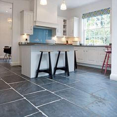 kitchen floor tile | marble kitchen floor and cabinet kicks | new