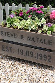 I like the idea of planting wedding flowers in a old crate with names and date of the wedding. then can put it in our garden! or on the porch!