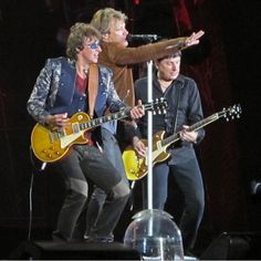Sayin' that this live pic of Jon Bon Jovi,Richie Sambora,and Bobby Bandiera is Amazing,is not enough.....There are no adjectives to describe it!