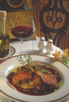 Roasted Rack of Lamb with Ratatouille Polenta and Black Olive Lamb Jus by Patrick Clark