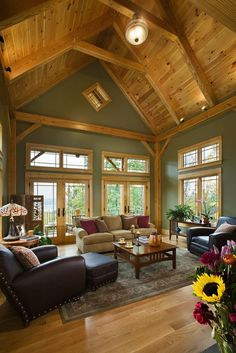 Great room photo in a pre-designed Woodhouse timber frame home