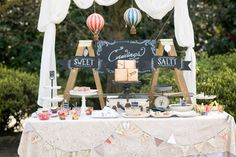 Dessert table at the vintage style Baby Marek Gender Reveal Party