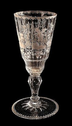 "A fine etched wine goblet (Pokal) attributed to Christian Gottfried Schneider Silesia, Warmbrunn, circa 1740. Engraved with four allegorical panels and inscribed ""Hoffnung"" (Hope), ""Gedult (Patience), ""Zeit"" (and Time"" - European Glass - Carter's Price Guide to Antiques and Collectables"