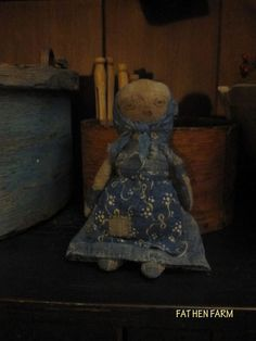 """She is made from wonderful early blue calico and homespun. She is stuffed with old cloth and approx. 7 1/2"""" tall. I love her arms made from scraps of an old quilt!  Perfect for a larger doll's lap! $55 includes US priority shipping."""