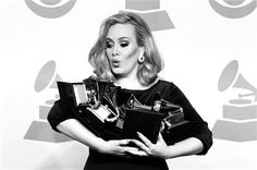 Adele juggles her 6 Grammy's at the 2012 Grammy Awards