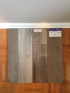 Sherwin Williams Requisite Gray paired with White trim; Armstrong Seaside Pine Dockside Laminate