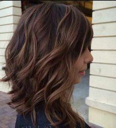 Dark brunette base with rooted auburn bayalage