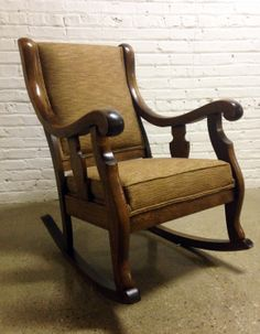 Hand carved walnut rocking chair that we rebuilt the suspension and reupholstered