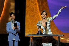 Actress Halle Berry (R) accepts the award for Outstanding Actress in a Motion Picture for 'Frankie & Alice' from presenter Prince onstage at the 42nd NAACP Image Awards held at The Shrine Auditorium on March 4, 2011 in Los Angeles, California.