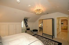 Private, secluded, heaven for a teenager! Bedroom #5 is on the east end of the third floor.  Elegant marble bath with glass shower adjoining playroom, sewing room/study, dormer windows with window seats, large walk-in cedar closet.