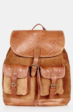 d6c2e17e0384 This tan Topshop suede backpack is perfect for holding all your festival  essentials.