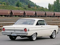 1964 Falcon. Great cars (though I don't like these wheels).