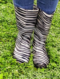 Photo about A close-up view of a pair of gumboots in the rain. Image of south, africa, boots - 59169684