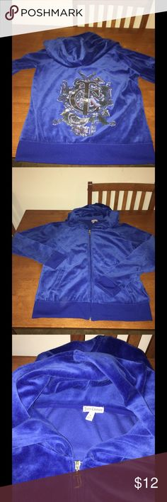 Juicy Couture Velour Track Jacket Large Juicy Couture classic velour track jacket.  Hooded style with brand logo zipper pull.  Back is brand graphic print.  Size large.  Excellent condition!!   Important:   All items are freshly laundered as applicable prior to shipping (new items and shoes excluded).  Not all my items are from pet/smoke free homes.  Price is reduced to reflect this!   Thank you for looking! Juicy Couture Tops Sweatshirts & Hoodies