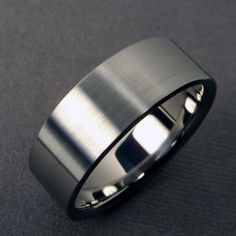 Mens Wedding Band - Titanium polished and satin | Minimalist titanium wedding band. Something like this would be perfect for Rob. It's sleek and simple, titanium is the hardest metal you can buy and it's inexpensive.