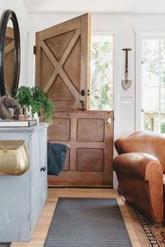 Love the Dutch door in this rustic farmhouse!