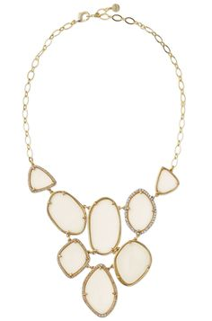 Fiona Bib Necklace - Segments of luminous ivory epoxy are bezel set and surrounded by over 200 glass stones for a crisp, modern statement. http://www.stelladot.com/stephaniebacot