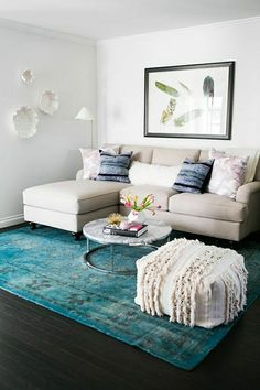 Beige sofa is pug-friendly, but the rug gives a pop of color. www.daintyhooligan.com