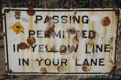 Passing permitted rusty old sign