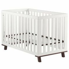Nod goes mod with our contemporary, low profile crib. Designed to make getting baby in and out easier on you, any time day or night. Fresh, minimal look is easy to coordinate. *Safety Features* Meets or exceeds all U.S. government safety, ASTM and CPSC standards For Toddler Bed use. Highest rated crib on Consumer Reports for safety and ease of use! nursery crib white modern walnut