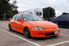 clean, my honda is a metallic orange,black WORK rims 18 back and front inside interior black seats sprco racing wheel no body kits with pink beaks on the back Honda Civic 1995, Honda Civic Vtec, Honda Civic Coupe, Custom Wheels, Custom Cars, Black Wheels, Black Rims, Civic Eg, Honda Civic Hatchback
