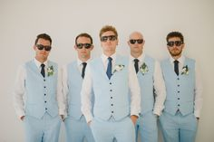 Baby blue vest and sunglasses are groomsmen's cool attire for outdoor wedding ideas   A Nautical-Themed Destination Wedding In Bali   http://www.bridestory.com/blog/a-nautical-themed-destination-wedding-in-bali