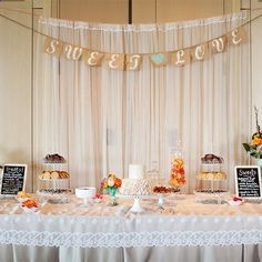 Real Weddings - In Bliss Weddings: Cookies, cake and other pastries lined the sweets table, along with the brides drink of choice: milk. Image Credits: Bethany F. Photography
