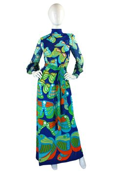 It may be gloomy outside but I have COLOR for you today! This 1960s Butterfly Print La Mendola Maxi dress is amazing!