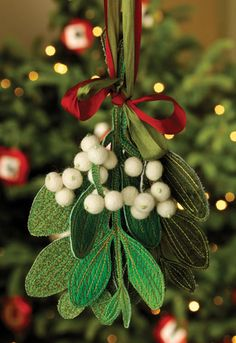 Magical Mistletoe bySusan Brubaker Knapp  Made with three different shades of green fabric, double sided ultra firm stabilizer, variegated green thread for machine stitching, white felted balls, and silk ribbons for hanging. (The pattern is available for purchase as a download.)