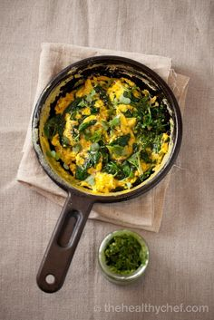 Super Charged Scrambled Eggs | Pimp up your scrambled eggs with this recipe that adds tumeric, chia, spinach and pesto. A quick and healthy protein-rich meal for anytime of the day.