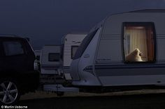 Home sweet home: Chara appears more than happy in her camper van - viewers can even imagine her sitting back to watch the television