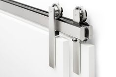 The Ragnar sliding door hardware system is available in bypassing without the brackets most systems need to hold up the outmost track. This creates a floating, clutter-free effect using Krownlab's industry-unique, truly concealed fasteners.