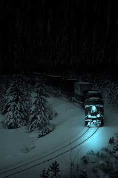 Train traveling at night through the snow.