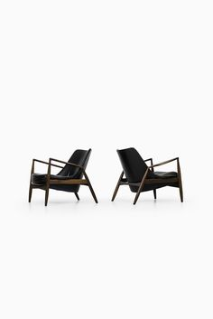 Rare pair of Seal chairs designed by Ib Kofod-Larsen and produced by OPE in Sweden