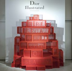 """This exhibition designed by Gitta Gschwendtner for London's Somerset House displayed fashion drawings on gauze-covered boxes. Brainstorm, Cannes, Window Display Design, Home Decor Quotes, Exhibition Display, Co Working, Stand Design, Retail Design, Decor Crafts"
