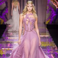 Couture Fashion Week has been stunning—just look to @karliekloss's gown from @versace_official's show for proof. Head to instyle.com to see all the most breathtaking designs so far! #couturefashionweek | photo: indigitalimages.com