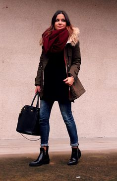 Shop this look on Lookastic:  https://lookastic.com/women/looks/parka-oversized-sweater-skinny-jeans/14932  — Burgundy Scarf  — Brown Parka  — Black Oversized Sweater  — Black Leather Tote Bag  — Navy Skinny Jeans  — Black Leather Ankle Boots