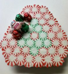 I saw this on Pinterest and decided to try it. It's peppermints! You just lay them out on parchment paper on a cookie sheet. Bake at 350 for 8 - 10 minutes... let them cool and there it is! (This the bottom side.. I like the way it looks better than the top.)  You can make any pattern you like.... a heart in the center would be cute for Valentines Day!   Then when you're done with it as a fun little serving tray for candies or cookies... you can break it up and have crushed peppermints to…