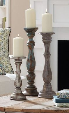 Simple decorating ideas like adding height to candles help change the feel of a space.  These aged candlesticks add a distressed look to your home dÌÎÌ__ÌÎå«Ì´å©cor.