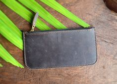 """Handmade Distressed Leather Rectangular Clutch with Zipper, Small Hand Purse, Leather Pencil Case, Personalized Gift (Dark Brown). Handmade Dark Brown Distressed Leather Rectangular Clutch with a Zipper. It can fit an iPhone 6 (5.5 inch) and an ID wallet. Product Features: Size: 20cm by 10cm (7.8"""" by 3.9"""") Weight: 55g Material: Distressed Cow Leather Color: Dark Brown (It has another color option-Hazelnut Brown) Features: Fit a 5.5inch iPhone 6 and an ID wallet. Can be used as a pencil…"""