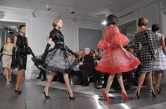 this has got to be Mad Men inspired - 50's and 60's....<3 the red dress and red stilettos