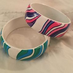 70s bangles 70s bangles. One purple and pink and th other green and blue Jewelry Bracelets
